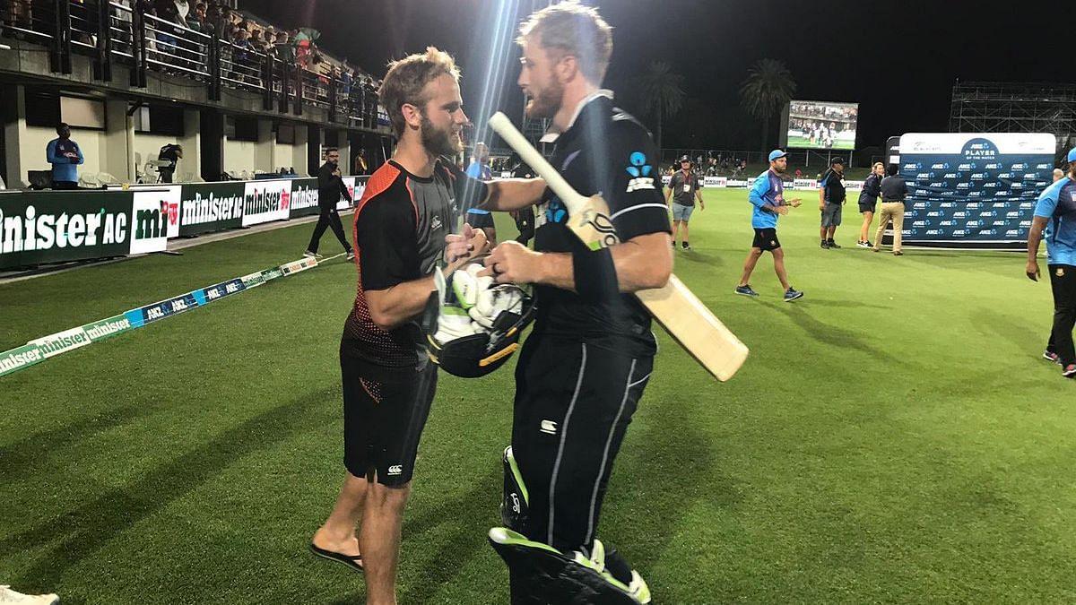 Captain Kane Williamson (left) congratulates centurion Martin Guptill after New Zealand beat Bangladesh in their first ODI at Napier.