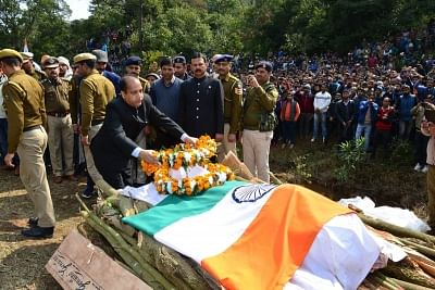 Kangra: Himachal Pradesh Chief Minister Jai Ram Thakur pays his last respects to martyr Tilak Raj, who was among the 49 CRPF personnel killed in a suicide attack by militants in Jammu and Kashmir