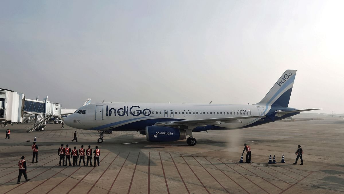Indigo Airlines' ground staff stand next to an aircraft. (Photo: Reuters)