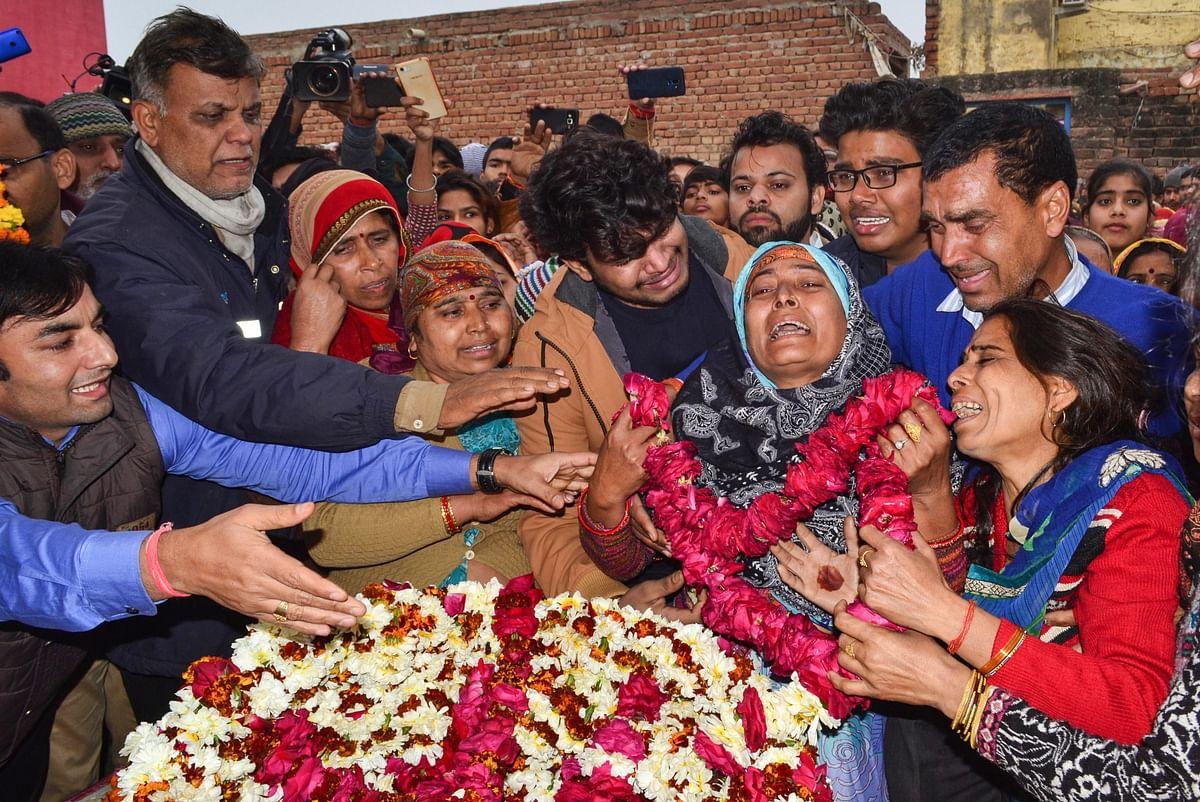 CRPF jawan Kaushal Kumar Rawat's family members bid their goodbyes, in Agra on 16 February 2019.