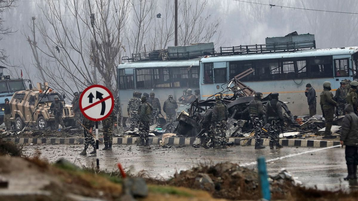 Security personnel carry out the rescue and relief works at the site of suicide bomb attack at Lathepora Awantipora in Pulwama district of south Kashmir, Thursday, 14 February. At least 40 CRPF jawans were killed and dozens other injured when a CRPF convoy was attacked.