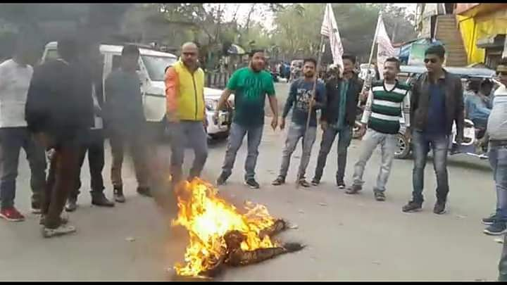 AJYCP activists burn the effigy of Excise Minister Parimal Suklabaidya.