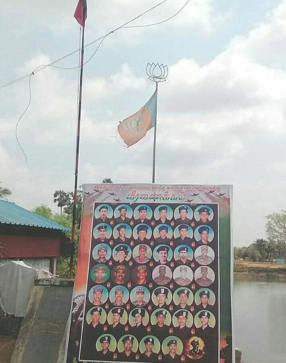 The poster has also been put up by a BJP unit, with the party flag flying above the poster.