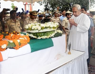 Bhubaneswar: Odisha Chief Minister Naveen Patnaik lays wreath at the coffin of martyr Manoj Kr Behra, one of the 45 CRPF personnel killed in 14 Feb Pulwama militant attack in Bhubaneswar on Feb 16, 2019. (Photo: IANS)