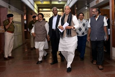 New Delhi: Union Home Minister Rajnath Singh, CPI leader D. Raja and other party leaders depart after the all party meeting on Pulwama terror attack at Parliament House, in New Delhi, on Feb. 16, 2019. (Photo: IANS)