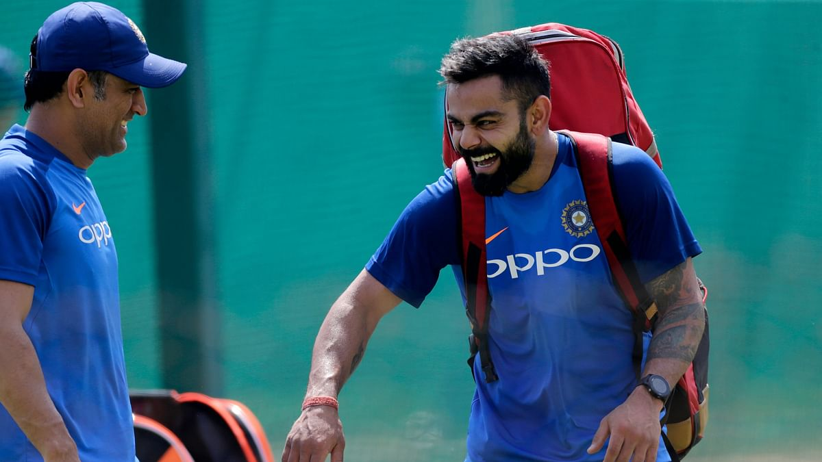 MS Dhoni and Virat Kohli share a laugh in the nets ahead of India's second ODI against Australia at Nagpur.