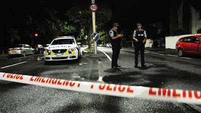 Policemen are seen on a road near the scene where the terror attack occurred in Christchurch, New Zealand.