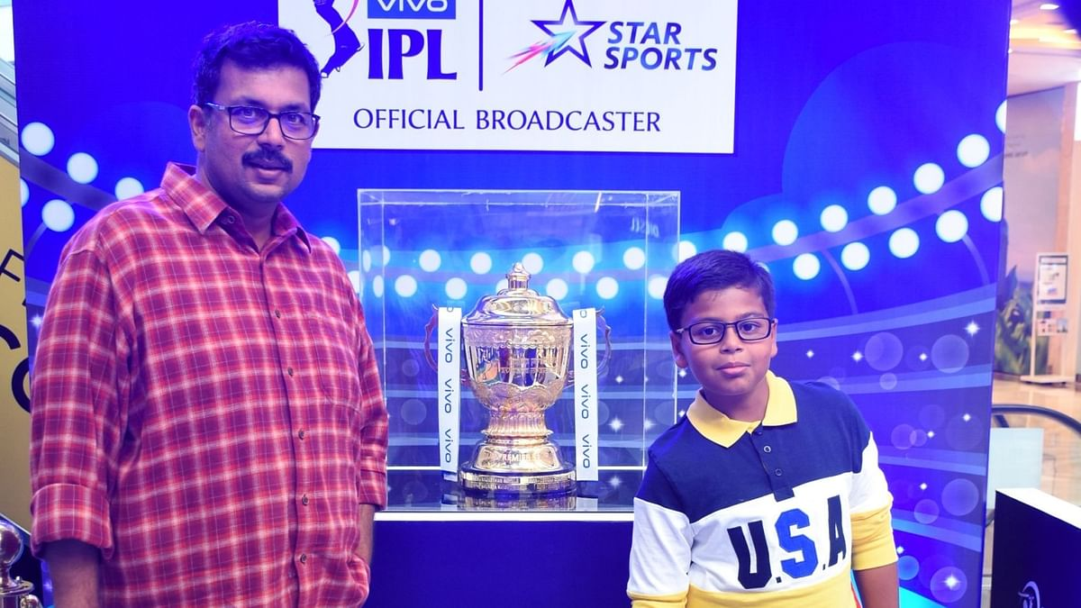 Fans with the IPL trophy in New Delhi.