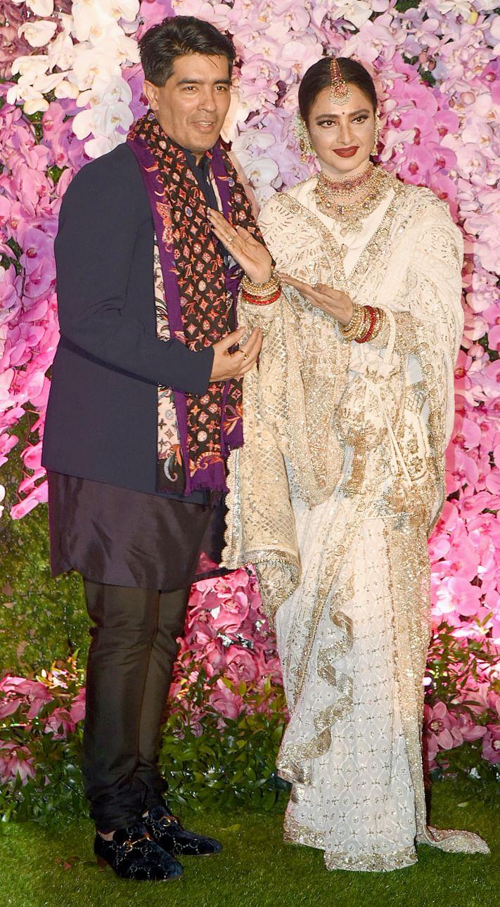 Fashion designer Manish Malhotra spotted with Rekha.