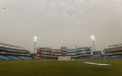 New Delhi: Floodlights are on as the fog envelops Ferozshah Kotla ground during Day 4 of the third test match between India and Sri Lanka at Feroz Shah Kotla Stadium in New Delhi on Dec 5, 2017. (Photo: Surjeet Yadav/IANS)
