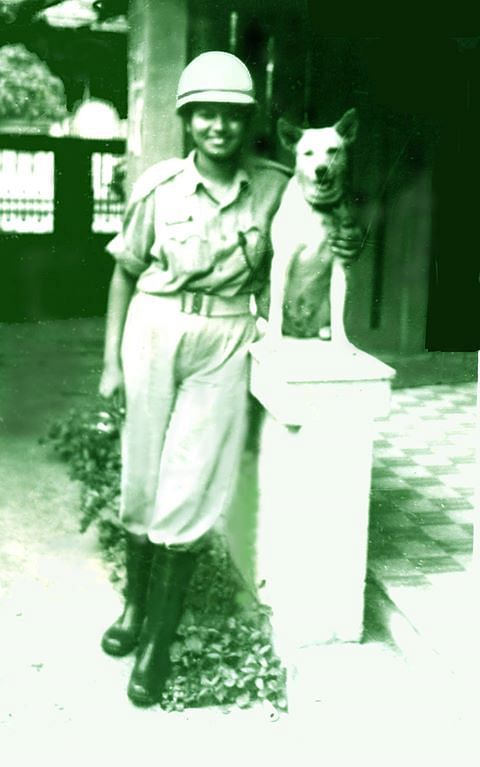 A photo of Harshini with her dog Lucky.