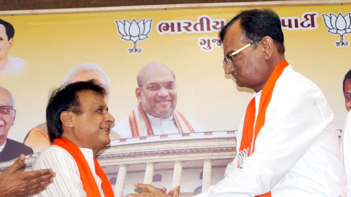 Former Gujarat MLA Jawahar Chavda (left) joins the BJP after quitting the Congress party. He is welcomed to the party by Minister of State for Home Pradipsinh Jadeja.