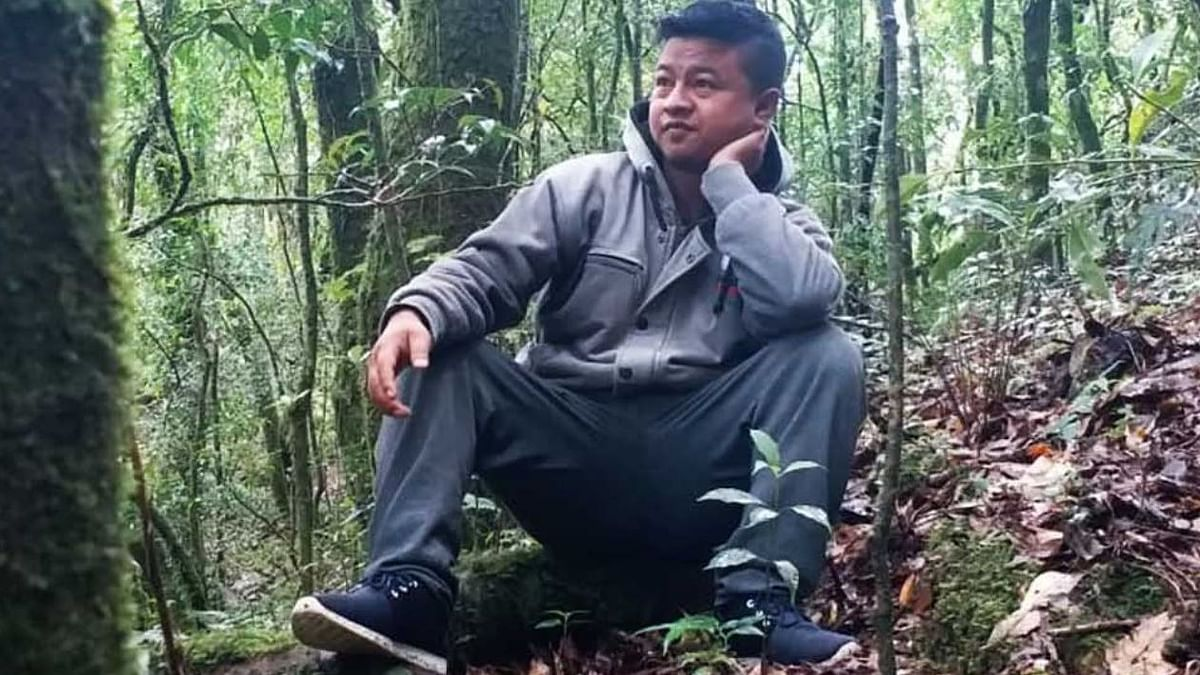 Borhlang Blah, 27, inside a sacred grove – a community forest protected by his village – in Mawphlang, Meghalaya.
