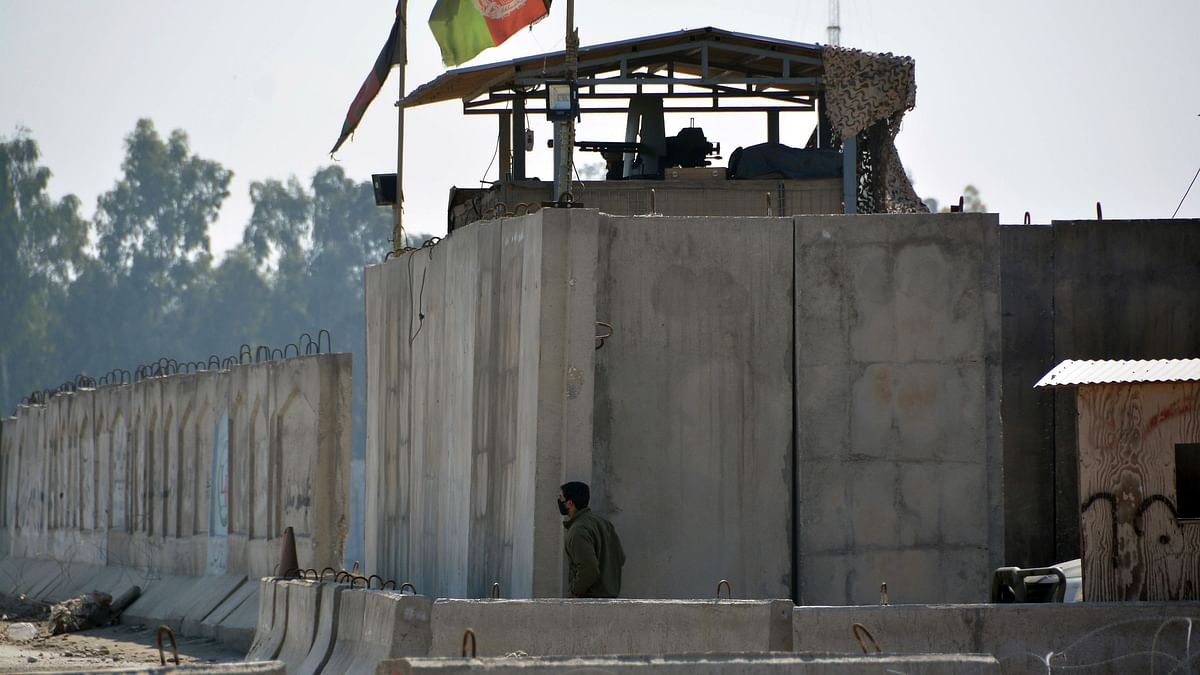 An Afghan security personnel stand guard in the checkpoint of airport after a suicide attack in Jalalabad province, east of Kabul, Afghanistan.
