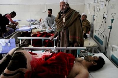 NANGARHAR, March 6, 2019 (Xinhua) -- Injured men receive medical treatment at a local hospital after an attack in Nangarhar province, Afghanistan, March 6, 2019. A total of 21 people including five attackers were killed and nine others injured as a blast followed by gun shots rocked Jalalabad city, the capital of eastern Nangarhar province on Wednesday, provincial government spokesman Attaullah Khogiani said. (Xinhua/Saifurahman Safi/IANS)