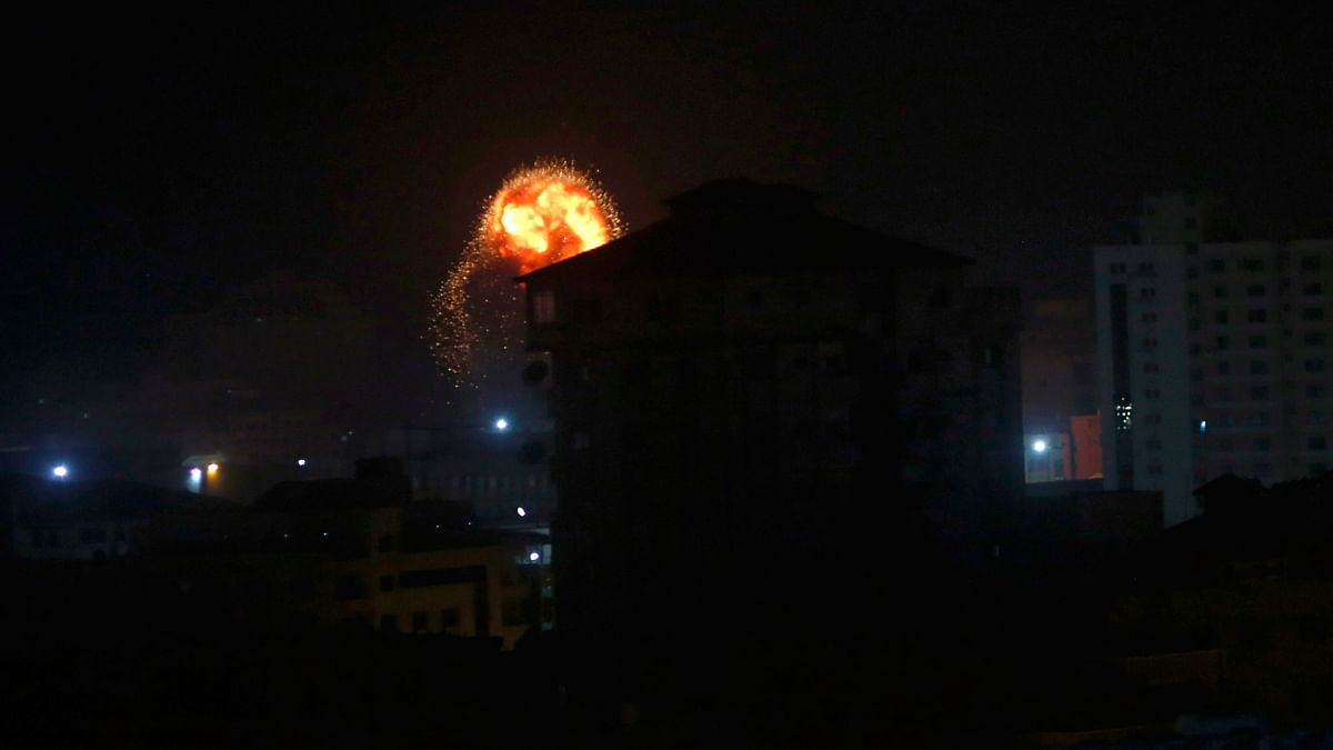 An explosion caused by Israeli airstrikes is seen on Gaza City, early Friday, 15 March, 2019.