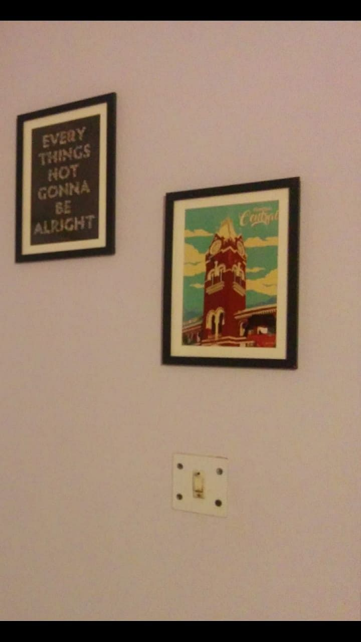 The poster of the railway station hanging on the wall in my current residence.