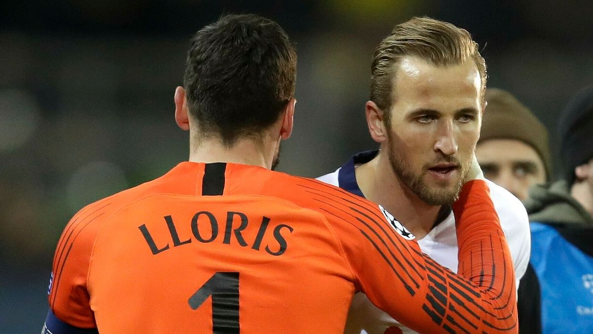 Tottenham goalkeeper Hugo Lloris greets Tottenham forward Harry Kane after the Champions League round of 16, 2nd leg, soccer match between Borussia Dortmund and Tottenham Hotspur at the BVB stadium in Dortmund, Germany, Tuesday, March 5, 2019. Spurs won the match 1-0 (4-0 on aggregate).