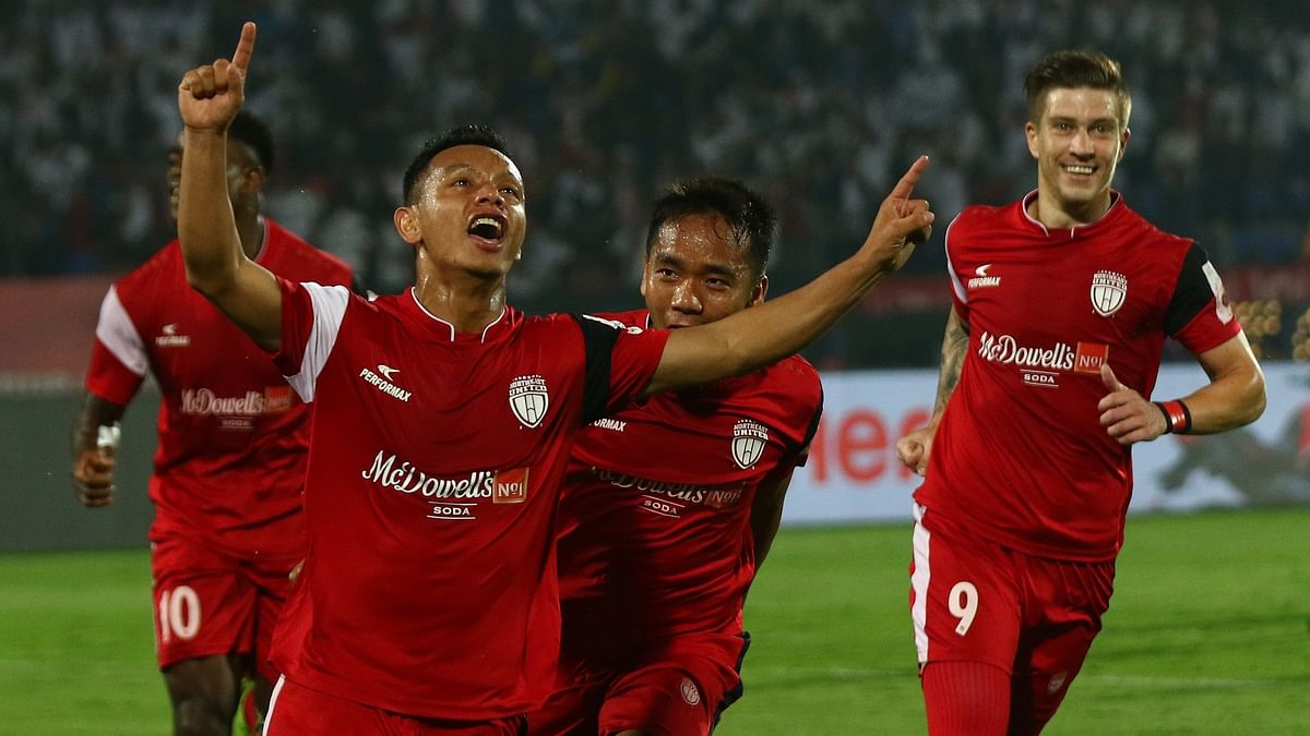 NorthEast United FC players celebrate their lead in the first half against Bengaluru FC on Thursday.