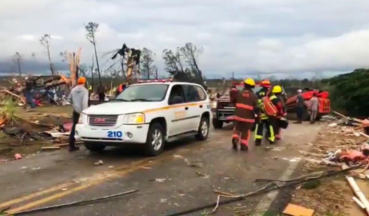 Emergency responders work in the scene amid debris in Lee County, Alabama.
