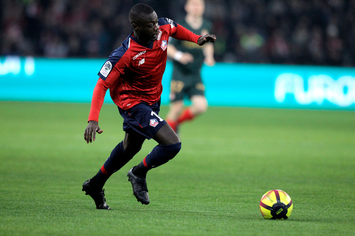 Lille's Nicolas Pepe controls the ball during the French League One soccer match between Lille and Monaco at the Lille Metropole stadium, in Villeneuve d'Ascq, northern France, Friday, March 15, 2019.