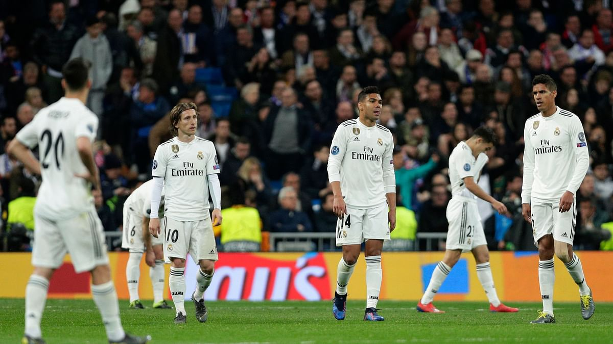 Real Madrid player react as Ajax's Dusan Tadic celebrates scoring his side's 3rd goal, during the Champions League soccer match between Real Madrid and Ajax at the Santiago Bernabeu stadium in Madrid, Spain, Tuesday, March 5, 2019.
