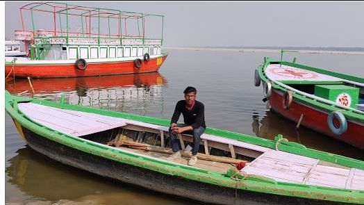 Ravi Sahani, a boatman in Varanasi, Uttar Pradesh, said fewer people are interested in a boat ride on the Ganga, affecting his only source of income. The river water is dark and the air smoggy. Tourists complain the air makes them cough and causes their skin to itch