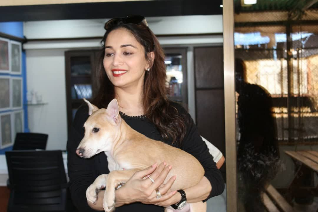 Madhuri poses with the new member.