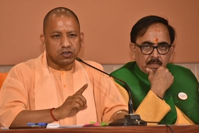 Lucknow: Uttar Pradesh Chief Minister and BJP leader Yogi Adityanath along with state party President Mahendra Nath Pandey addresses a press conference in Lucknow, on March 19, 2019. (Photo: IANS)