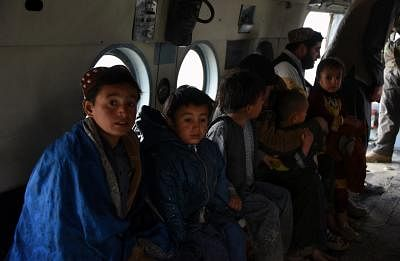 KANDAHAR, March 3, 2019 (Xinhua) -- A military helicopter carries local people during an evacuation operation after a flood in Kandahar province, Afghanistan, March 2, 2019 . At least 20 people were killed and many others went missing after flash floods hit Afghanistan