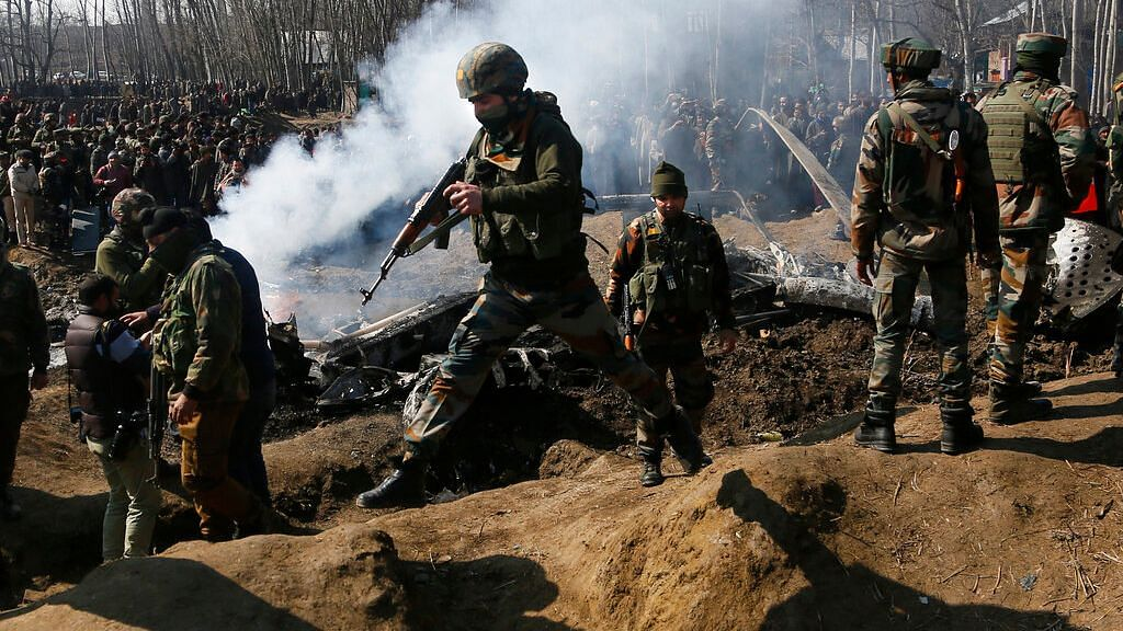 Feb. 27, 2019. Indian Army soldiers arrive at the wreckage of an an Indian helicopter after it crashed in Budgam area. Image used for representation.