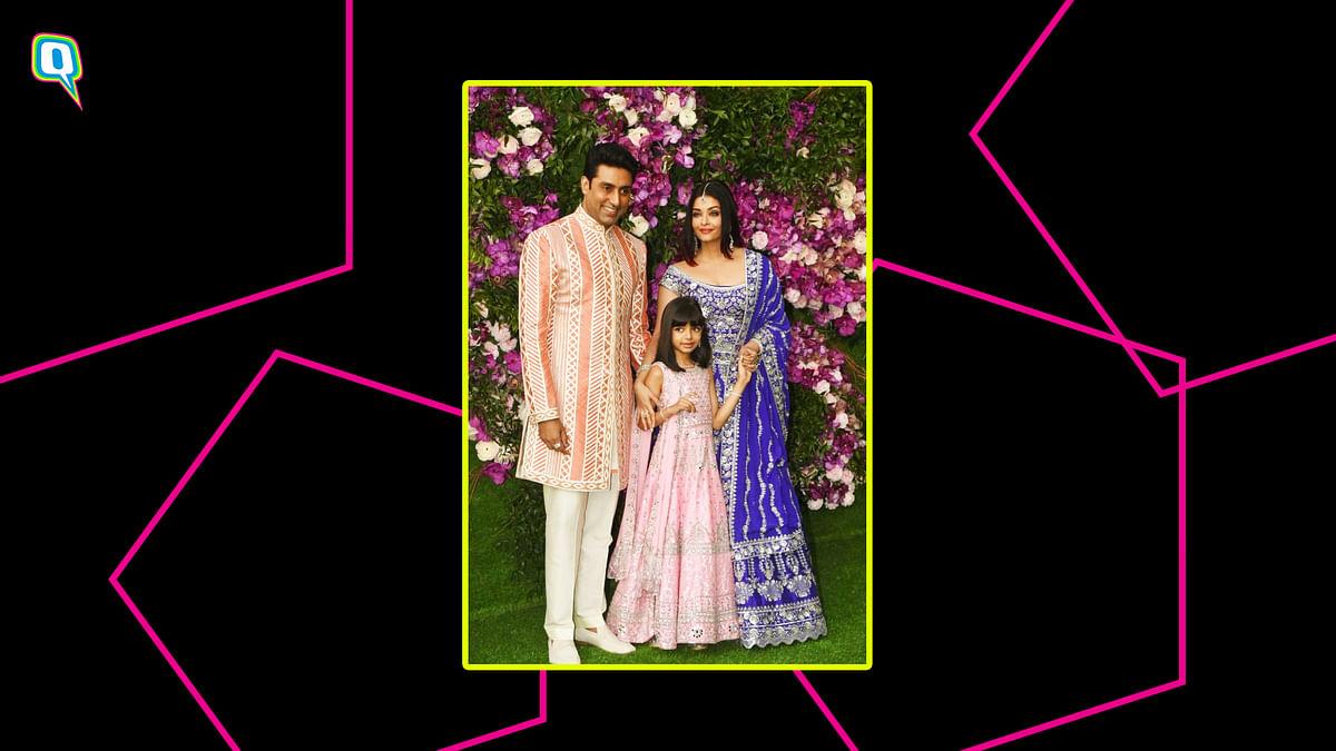 Abhishek Bachchan (L), Aishwarya Bachchan and Aaradhya Bachchan