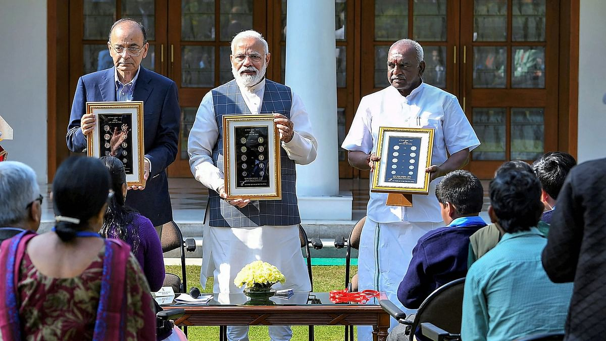 Prime Minister Narendra Modi releases the new series of visually impaired-friendly circulation coins at a function in New Delhi.