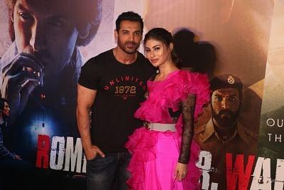"Mumbai: Actors John Abraham and Mouni Roy at the trailer launch of their upcoming film ""Romeo Akbar Walter"", in Mumbai, on March 4, 2019. (Photo: IANS)"