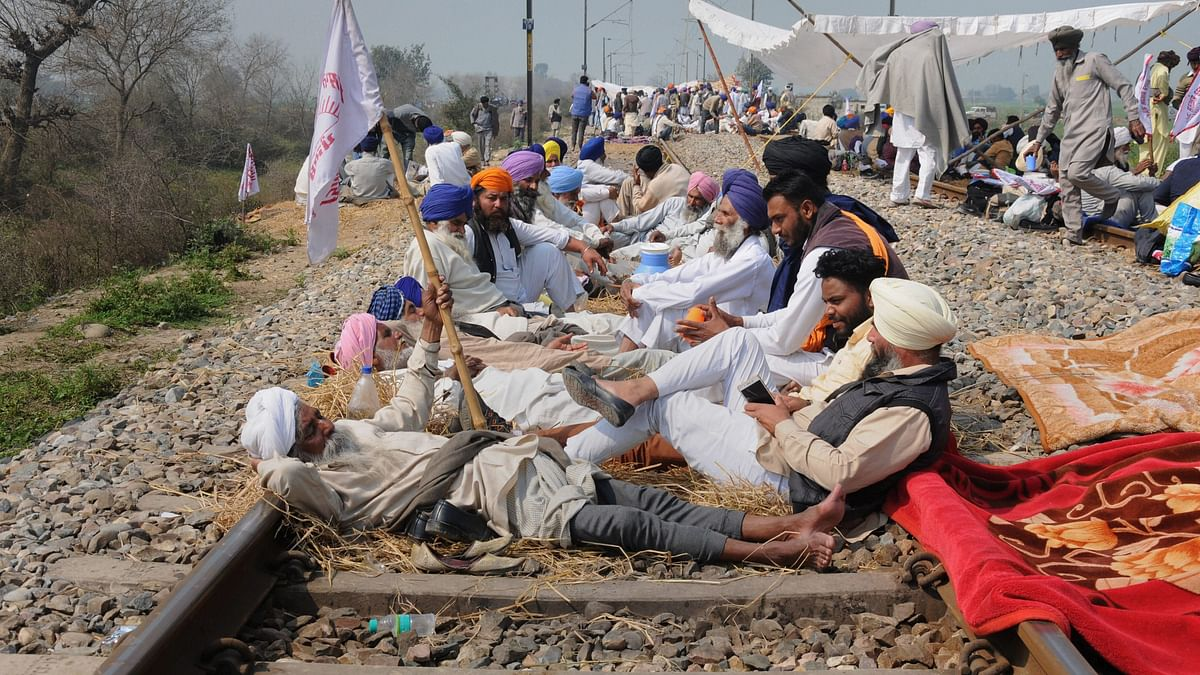 Farmers block a railway track during a protest organised under the banner of Kisan Mazdoor Sangharsh Committee (KMSC) in Amritsar.