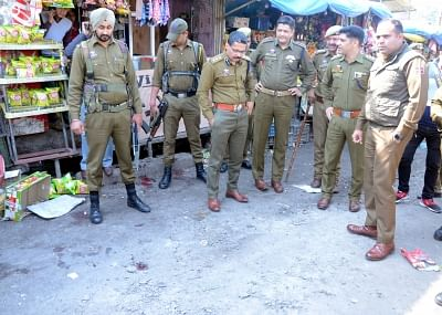 Jammu: Security personnel carry out investigations at the site where at least one person was killed and 30 others were injured when a grenade flung under a parked bus by a militant exploded at Jammu