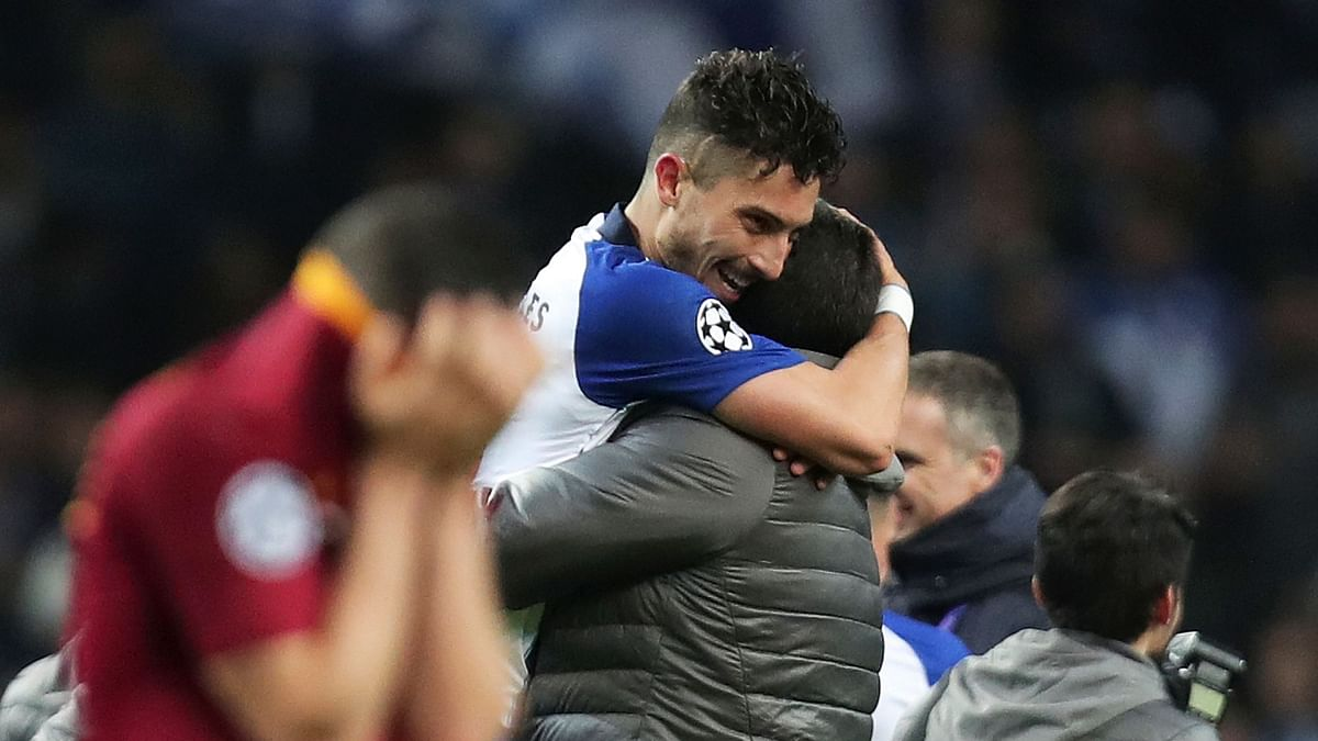 Alex Telles scored a penalty in extra time to send Porto into the Champions League quarter-finals with a 3-1 victory over Roma.