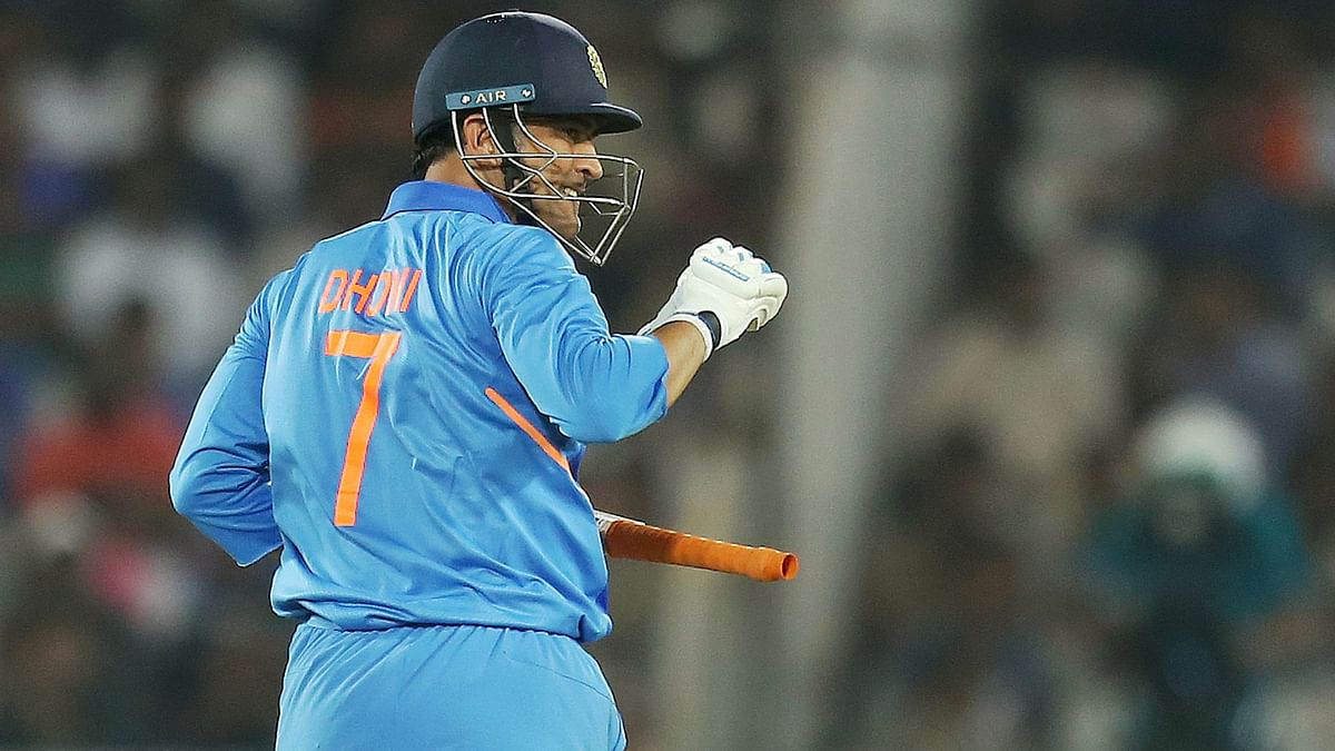 MS Dhoni, seen here batting during the first ODI between India and Australia, was quick to assume driver duties as Team India arrived in his hometown, Ranchi.
