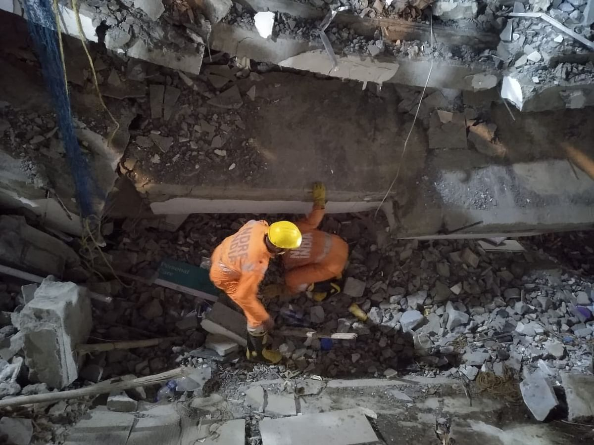 Rescue operations underway at the collapse site in Dharwad.