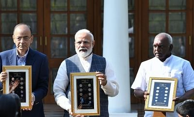 New Delhi: Prime Minister Narendra Modi releases the new series of visually impaired friendly circulation coins, in New Delhi, on March 7, 2019. Also seen Union Finance Minister Arun Jaitley and Union MoS Finance P. Radhakrishnan. (Photo: IANS/PIB)