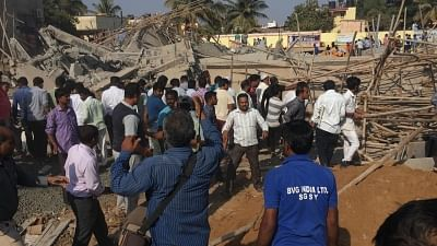 Dharwad: People gather at the site where an under construction multi-storey building collapsed leaving two people killed and 50 others trapped in Karnataka
