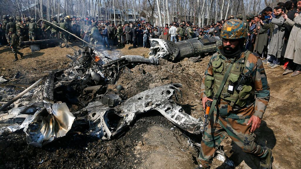 Indian Army soldiers arrive at the wreckage of an an Indian helicopter after it crashed in Budgam area, outskirts of Srinagar on Wednesday, 27 February, 2019.