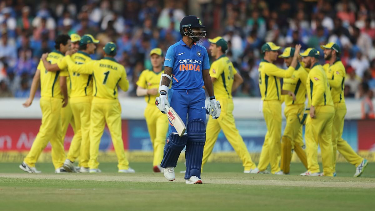 India's Shikhar Dhawan leaves the field after his dismissal by Australia's Nathan Coulter-Nile during the first one day international in Hyderabad on 2 March.
