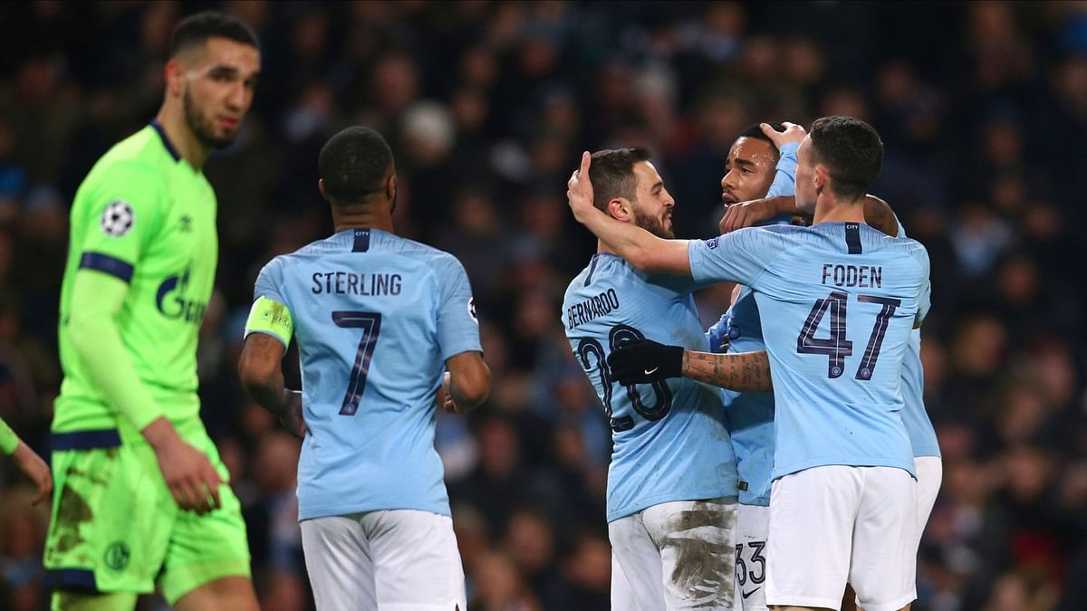 Manchester City players celebrate after  Gabriel Jesus scored his side's seventh goal during the Champions League round of 16 second leg, soccer match.