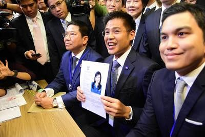 BANGKOK, Feb. 8, 2019 (Xinhua) -- Thai Raksa Chart party leader Preechapol Pongpanich (C) holds the registration document of Princess Ubolratana Mahidol in Bangkok, Thailand, Feb. 8, 2019. Thai Raksa Chart party on Friday nominated Princess Ubolratana Mahidol as their candidate for prime minister. (Xinhua/IANS)