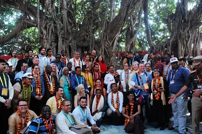 Prayagraj: Foreign delegates during the visit to the ongoing Kumbh mela in Prayagraj on Feb 22, 2019. Two hundred and twenty delegates from 185 countries across the world landed in the city to take part in the festival. These visitors are part of a delegation of the Indian Council for Cultural Relations (ICCR) that was invited specially for the religious congregation. The delegates were accompanied by Minister of State for External Affairs V.K. Singh. (Photo: IANS)
