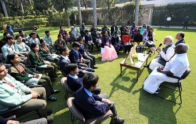 New Delhi: Prime Minister Narendra Modi interacts with visually impaired children during the release of new series of visually impaired friendly circulation coins, in New Delhi, on March 7, 2019. Also seen Union Finance Minister Arun Jaitley and Union MoS Finance P. Radhakrishnan. (Photo: IANS/PIB)
