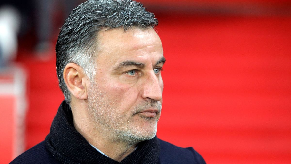 Lille's coach Christophe Galtier looks on at the start of the French League One soccer match between Lille and Monaco at the Lille Metropole stadium, in Villeneuve d'Ascq, northern France, Friday, March 15, 2019.