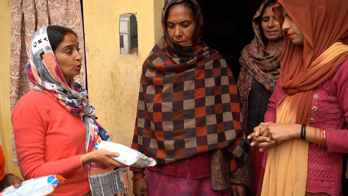 These women go door-to-door selling pads and explaining women the benefits of using them.