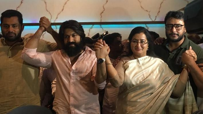Sumlatha, along with actors Yash and Darshan, during the press conference in Bengaluru.